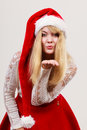 Happy cute woman in santa helper hat. Christmas. Royalty Free Stock Photo