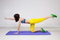 Happy cutie athletic girl execute exercise on muscles belly Royalty Free Stock Photos
