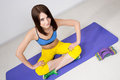 Happy cutie athletic girl execute exercise on muscles belly Stock Images