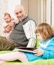 Happy dad with daughters father and two young at home Royalty Free Stock Photo