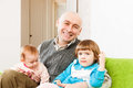 Happy dad with daughters father and two young at home Royalty Free Stock Photos