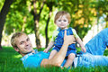 Happy daddy with  baby in a greenl summer park Royalty Free Stock Image
