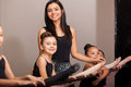 Happy dance instructor in class beautiful young coaching her female students a academy Stock Image