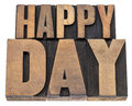 Happy day in wood type isolated text vintage letterpress printing blocks Royalty Free Stock Image