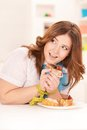 Happy dieting woman with cake and measuring tape Royalty Free Stock Photos