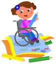 Happy disabled girl drawing with big crayon