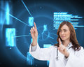 Happy doctor pointing composite image of brunette Royalty Free Stock Photos