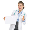 Happy doctor woman showing blank paper sheet and thumbs up Royalty Free Stock Photo