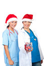 Happy doctors women giving Christmas gift