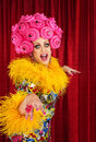 Happy drag queen dancing in pink foam wig Stock Images