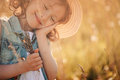 Happy dreaming child girl holding bouquet in summer Royalty Free Stock Photo