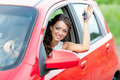 Happy driver in red car Stock Photo