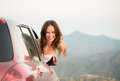Happy driver woman on summer vacation showing thumb up sign against mountains background vacations concept Stock Photo