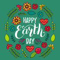 Happy Earth Day hand lettering card background. Vector illustration with leaves and flowers in floral pattern frame.