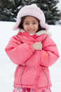 Happy East Indian girl playing in the snow Royalty Free Stock Images