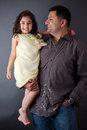 Happy East Indian man with his daughter Stock Images
