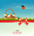 Happy Easter background. Colorful Easter eggs and green grass.