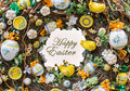 Happy easter background spring motive greeting card with sign wreath toys painting eggs and buttons Royalty Free Stock Image