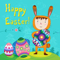 Happy easter boy dressed as bunny with eggs Royalty Free Stock Photos