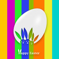 Happy easter bunnies a graphic of a white egg with heads of on it on a multicolore background Royalty Free Stock Photo