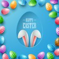 Happy Easter card with bunny ears hiding in egg hole and colorful eggs frames on blue background Royalty Free Stock Photo