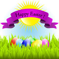 Happy easter card colorful eggs lie on the grass Stock Image
