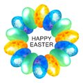 Happy Easter. Card watercolor easter wreath of blue, yellow and green eggs in spots. In the middle text.