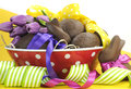 Happy easter chocolate easter eggs and bunny rabbit hamper with colorful polka dot and stripe ribbon in red polka dot bowl Stock Photo