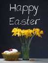Happy easter daffodil in a glass with eggs and little gift Royalty Free Stock Photography