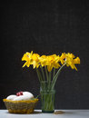 Happy easter daffodil in a glass with eggs and little gift Royalty Free Stock Image