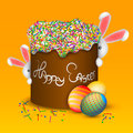 Happy easter. Easter cake and eggs. Funny rabbits