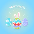 Happy Easter. Easter greeting card with colorful eggs and bunny ears on blue background. Royalty Free Stock Photo