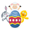 Happy easter egg with animals a bunny rabbit a lamb and a cute chick lurking behind a big useful also as greeting card eps file Stock Images