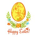 Happy easter egg with ornament on a white background with green leaves and flowers and the words Stock Photography
