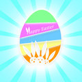Happy easter egg three heads of bunnies on a colorful on a light rays background Royalty Free Stock Photos