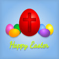 Happy easter eggs card with cross symbol over blue background Stock Photo