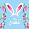 Happy Easter eggs decoration with plants leaves and rabbit ears diadem