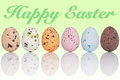 Happy easter eggs in a line six candy coated chocolate with the text on graduated background Royalty Free Stock Photo