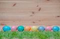 Happy easter eggs pastel colored with grass on the vintage wooden background Royalty Free Stock Photography