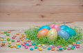 Happy easter eggs pastel colored in a nest with on the vintage wooden background Stock Images
