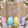 Happy Easter lettering, painted colorful eggs. Spring holidays, Easter background, blossom tree