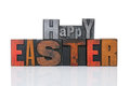 Happy easter in letterpress words old metal and wooden isolated on a white bcakground Stock Photos