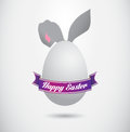 Happy easter poster cartoon bunny is hiding behind an egg Royalty Free Stock Images