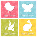 Happy easter silhouettes cards set a collection of four greeting card with animals silhouette chick butterfly dove and bunny Stock Image