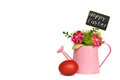 Happy Easter text, Easter eggs and fabric flowers arranged in watering bucket isolated