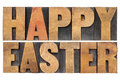 Happy easter in wood type isolated words vintage letterpress Stock Photography