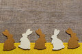 Happy easter: wooden background with rabbits for a greeting card Royalty Free Stock Photo