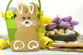 Happy Easter yellow and lime green theme gingerbread bunny cookie with basket, tulips, and candy birds eggs Royalty Free Stock Photo