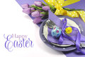 Happy easter yellow and purple mauve lilac theme easter table place setting with sample greeting or copy space for your text here Stock Images