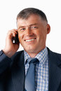 Happy Elder Businessman Speaking on the Mobile. Stock Photos